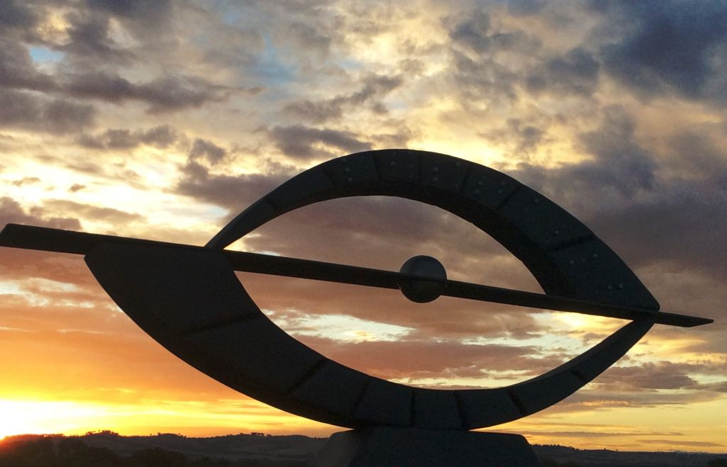 sunrise, curved lines, stainless steel and corten steel, Tactile lettering